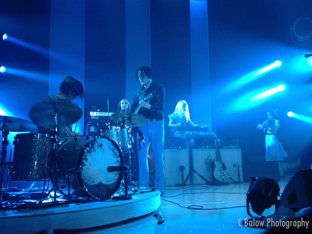 Jack White interacting with drummer Carla Azar.